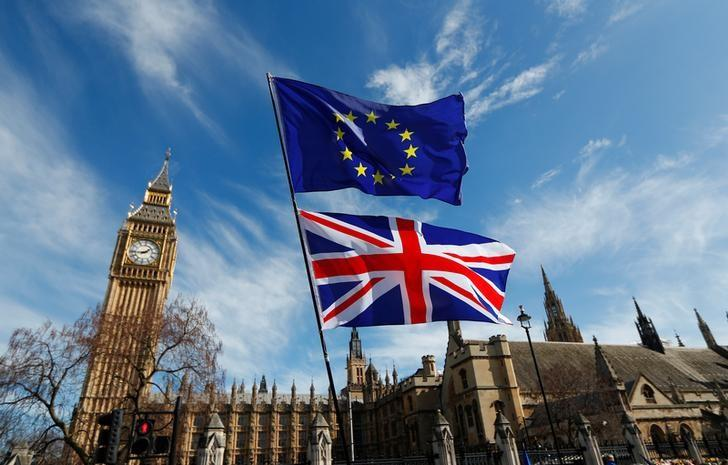EU and Union flags fly above Parliament Square during a Unite for Europe march, in central London, Britain March 25, 2017. REUTERS/Peter Nicholls/Files