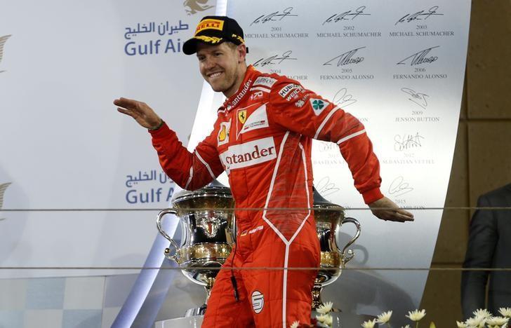 Formula One - F1 - Bahrain Grand Prix - Sakhir, Bahrain - 16/04/17 - Ferrari Formula One driver Sebastian Vettel of Germany celebrates after winning Bahrain Grand Prix. REUTERS/Hamad I Mohammed/Files