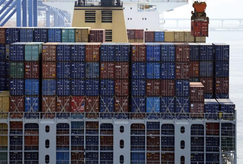 A crane carries a container (top R) from a ship at the PNC container terminal at the Busan New Port in Busan, about 420 km (261 miles) southeast of Seoul, August 8, 2013.  REUTERS/Lee Jae-Won
