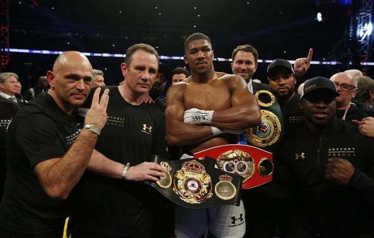 Britain Boxing - Anthony Joshua v Wladimir Klitschko IBF, IBO & WBA Super World Heavyweight Title's - Wembley Stadium, London, England - 29/4/17 Anthony Joshua celebrates with trainer Robert McCracken, promoter Eddie Hearn and his corner after winning the fight Action Images via Reuters / Andrew Couldridge Livepic/Files