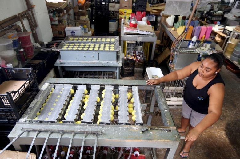 A woman works in a factory of citronella candles in Sao Joao da Boa Vista, Brazil, February 12, 2016.   REUTERS/Paulo Whitaker/File Photo