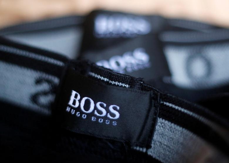 FILE PHOTO: The logo of German fashion house Hugo Boss is seen on a clothing label at their outlet store in Mezingen near Stuttgart October 29, 2013.  REUTERS/Michael Dalder/File Photo