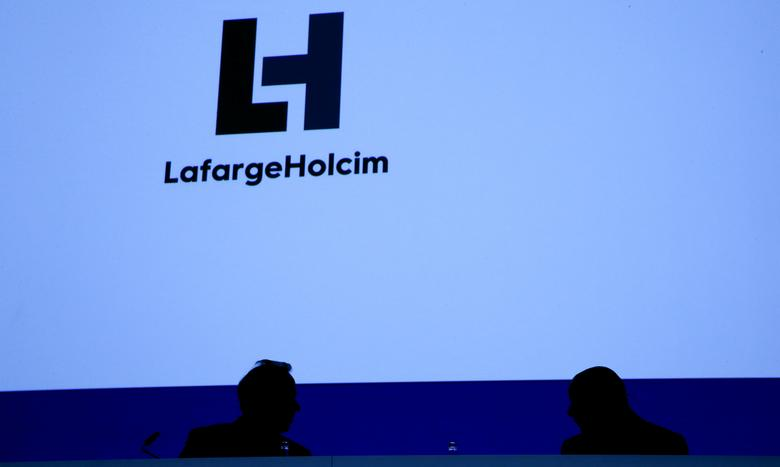 CEO Eric Olsen (L) and Chairman Beat Hess of Franco-Swiss cement giant LafargeHolcim attend the company's annual shareholder meeting in Zurich, Switzerland May 3, 2017.    REUTERS/Arnd Wiegmann