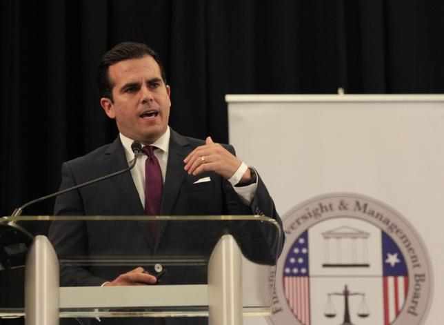 Puerto Rico's Governor Ricardo Rossello addresses the audience during a meeting of the Financial Oversight and Management Board for Puerto Rico at the Convention Center in San Juan, Puerto Rico March 31, 2017. REUTERS/Alvin Baez/Files