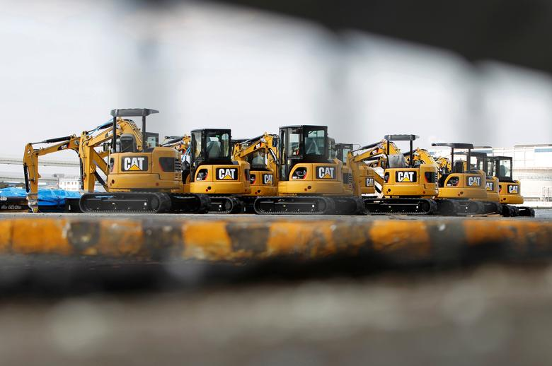 FILE PHOTO: New excavators are seen at a port in Yokohama, south of Tokyo February 10, 2011.   REUTERS/Toru Hanai/File Photo