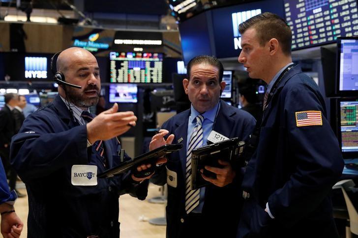 Traders work on the floor of the New York Stock Exchange (NYSE) in New York, U.S., May 1, 2017. REUTERS/Brendan McDermid