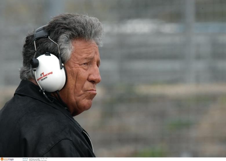 Mario Andretti watches testing Mandatory Credit: Action Images / Crispin Thruston