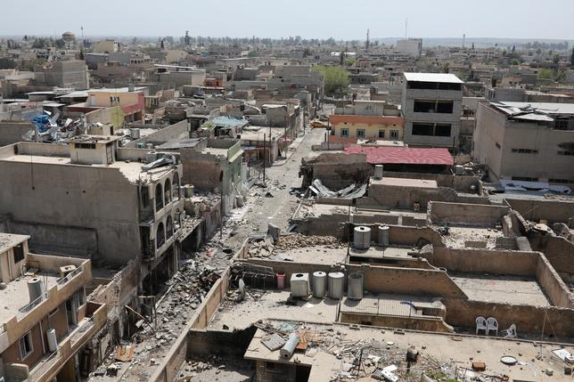 General view of destroyed buildings in Mosul. REUTERS/Marko Djurica