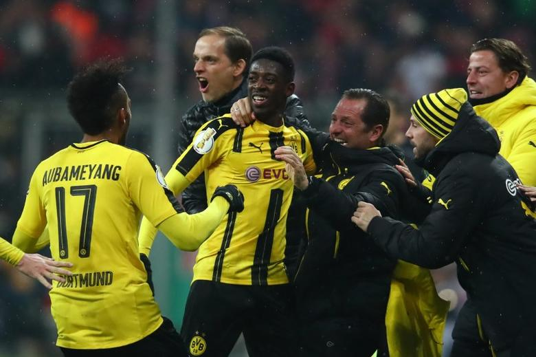 Soccer Football - Bayern Munich v Borussia Dortmund - DFB Pokal Semi Final - Allianz Arena, Munich, Germany - 26/4/17 Borussia Dortmund's Ousmane Dembele celebrates scoring their third goal with coach Thomas Tuchel and coaching staff Reuters / Michael Dalder Livepic