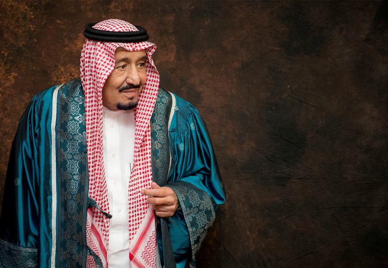FILE PHOTO: Saudi Arabia's King Salman poses after receiving an an honorary PhD from International Islamic University Malaysia (IIUM) in Kuala Lumpur, Malaysia February 28, 2017. Bandar Algaloud/Courtesy of Saudi Royal Court/Handout via REUTERS/File Photo
