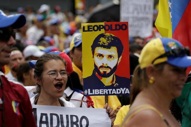 A placard depicting jailed Venezuelan opposition leader Leopoldo Lopez is seen during a rally in support of political prisoners and against Venezuelan President Nicolas Maduro, in Los Teques, Venezuela April 28, 2017. REUTERS/Marco Bello