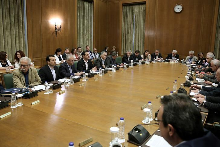 Greek Prime Minister Alexis Tsipras (4th L) and members of his government attend a cabinet meeting at the parliament in Athens, Greece May 4, 2017. REUTERS/Costas Baltas