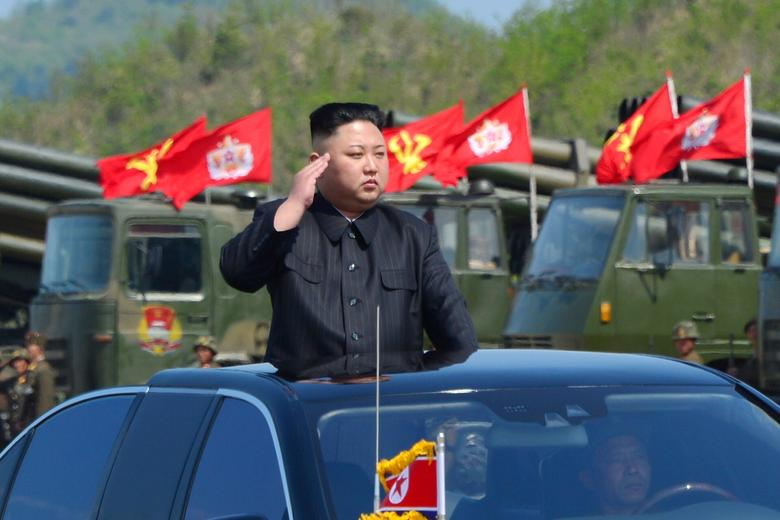 Kim Jong Un watches a military drill marking the 85th anniversary of the establishment of the Korean People's Army in this handout photo made available on April 26, 2017. KCNA/Handout via REUTERS