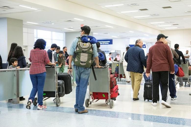 FILE PHOTO: International travellers arrive at Dallas/Fort Worth International Airport in Dallas, Texas, U.S. February 4, 2017.  REUTERS/Laura Buckman