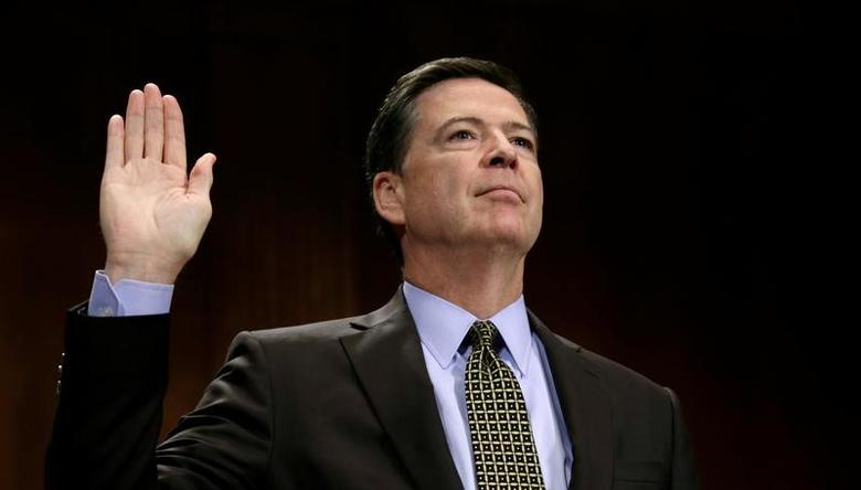 FBI Director James Comey is sworn in to testify before a Senate Judiciary Committee hearing on ''Oversight of the Federal Bureau of Investigation'' on Capitol Hill in Washington, U.S., May 3, 2017. REUTERS/Kevin Lamarque