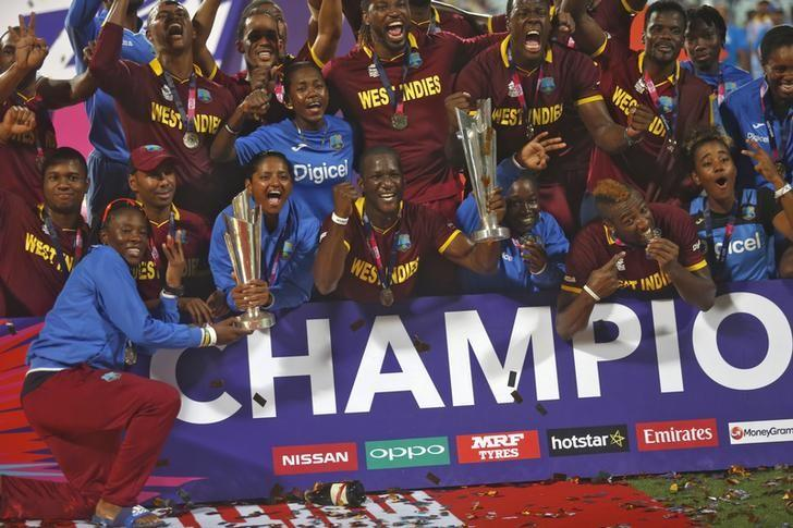 Cricket - England v West Indies - World Twenty20 cricket tournament final - Kolkata, India - 03/04/2016. West Indies men's and women's teams celebrate with their trophies after winning their finals.    REUTERS/Rupak De Chowdhuri/Files