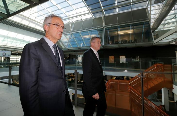 Macquarie Group Chief Executive Nicholas Moore (L) and Chief Financial Officer Patrick Upfold walk from a press conference after announcing the bank's latest earnings in Sydney, Australia, May 5, 2017.  REUTERS/Jason Reed