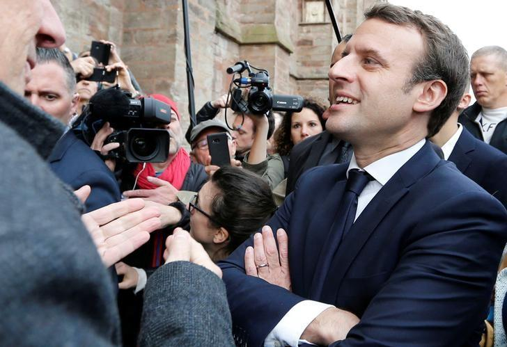 Emmanuel Macron, head of the political movement En Marche !, or Onwards !, and candidate for the 2017 presidential election, speaks with supporters during a campaign visit in Rodez, France, May 5, 2017. REUTERS/Regis Duvignau