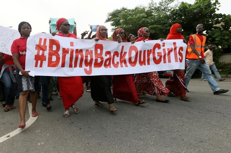 FILE PHOTO Nigerians take part in a protest demanding for the release of secondary school girls abducted from the remote village of Chibok, in Asokoro, Abuja May 13, 2014. REUTERS/Afolabi Sotunde/File Photo