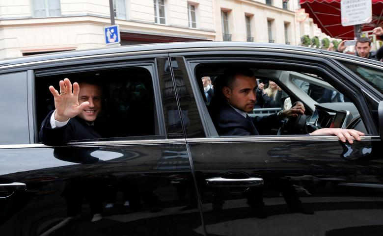 Emmanuel Macron, head of the political movement En Marche !, or Onwards !, and candidate for the 2017 presidential election, waves from his car as he leaves his home during the second round of the election, in Paris, France, May 7, 2017. REUTERS/Jean-Paul Pelissier