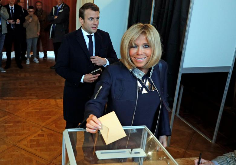 Brigitte Trogneux, the wife of French presidential election candidate Emmanuel Macron casts her ballot during the the second round of 2017 French presidential election, in Le Touquet, France, May 7, 2017. REUTERS/Philippe Wojazer