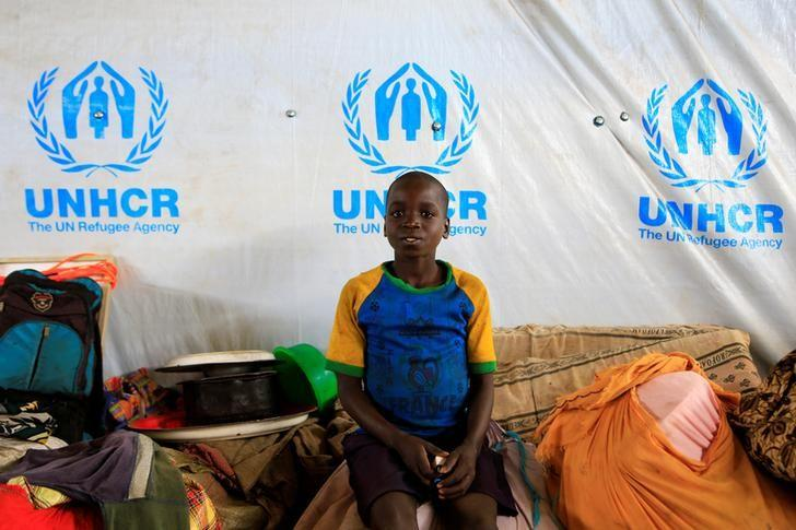 A boy displaced by fighting in South Sudan arrives in Lamwo after fleeing fighting in Pajok town across the border in northern Uganda, April 5, 2017. REUTERS/James Akena