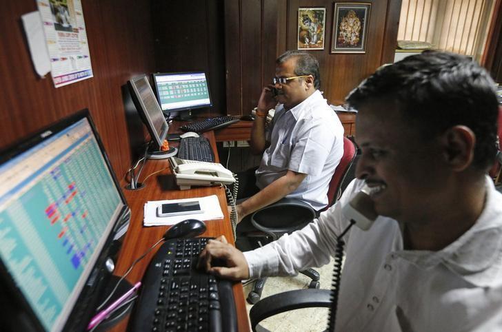 Brokers trade at their computer terminals at a stock brokerage firm in Mumbai January 15, 2015. REUTERS/Shailesh Andrade/Files