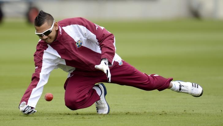 West Indies' Sunil Narine attempts to catch a ball during a training session before the third cricket test match against England at Edgbaston cricket ground in Birmingham June 5, 2012. REUTERS/Philip Brown/File Photo