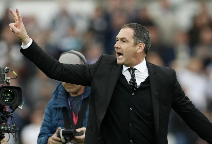 Britain Soccer Football - Swansea City v Everton - Premier League - Liberty Stadium - 6/5/17 Swansea City manager Paul Clement holds up two fingers representing the final two games left to play Action Images via Reuters / John Sibley Livepic