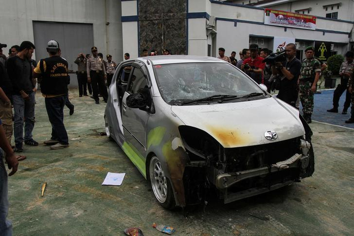 A damaged car is seen in the Sialang Bungkuk jail, after a riot during which prisoners escaped from the jail, in Pekanbaru, on Indonesia's Sumatra island, May 6, 2017.  Antara Foto/Rony Muharrman via REUTERS