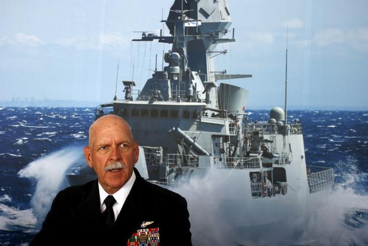Commander of the U.S. Pacific Fleet Admiral Scott Swift sits in front of a large poster of an Australian Navy frigate as he speaks during a media conference at the 2015 Pacific International Maratime Exposition in Sydney, Australia, October 6, 2015. REUTERS/David Gray/Files