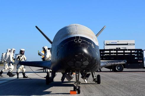 Plane lands after secret, two-year mission