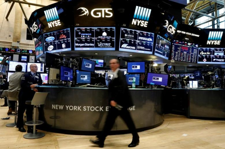 FILE PHOTO: Traders work on the floor of the New York Stock Exchange (NYSE) in New York, U.S., May 3, 2017. REUTERS/Brendan McDermid