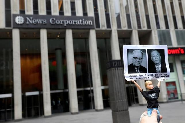 A protester opposing Fox News Channel TV anchor Bill O'Reilly holds a doll up outside the News Corporation headquarters in New York City, U.S. April 19, 2017. REUTERS/Shannon Stapleton/Files