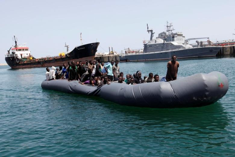 Illegal migrants arrive in a dinghy at a naval base after they were rescued by Libyan coastguard in the coastal city of Tripoli, Libya, May 6, 2017. REUTERS/Ismail Zitouny