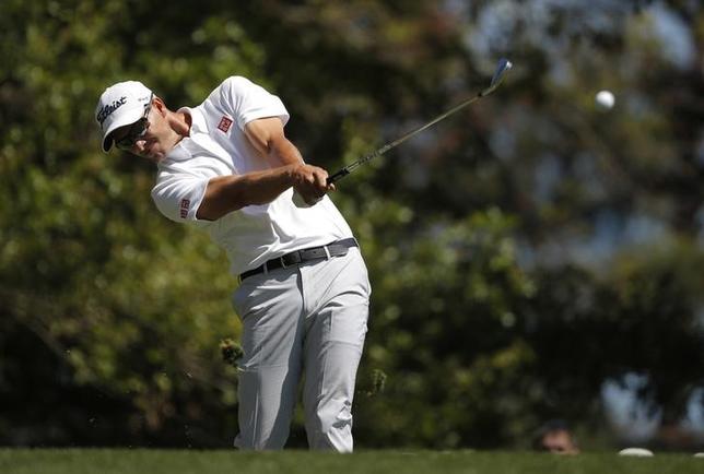 5月8日、男子ゴルフの元世界ランク1位、アダム・スコットは、選手としての全盛期はまだ先にあると信じている、と先週ロイターに述べた。米ジョージア州オーガスタで4月撮影(2017年 ロイター/Lucy Nicholson)