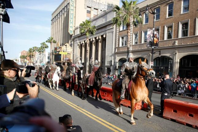 Mounted warrior knights ride horses along Hollywood Blvd. as extras for the premiere of ''King Arthur: Legend of the Sword'' at the TCL Chinese Theatre IMAX, in Hollywood, California, U.S., May 8, 2017. REUTERS/Danny Moloshok