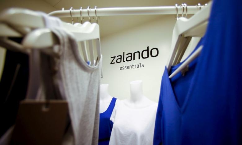 A Zalando logo is seen printed on a wall in a showroom of the fashion retailer Zalando in Berlin, October 14, 2014.  REUTERS/Hannibal Hanschke/File Photo