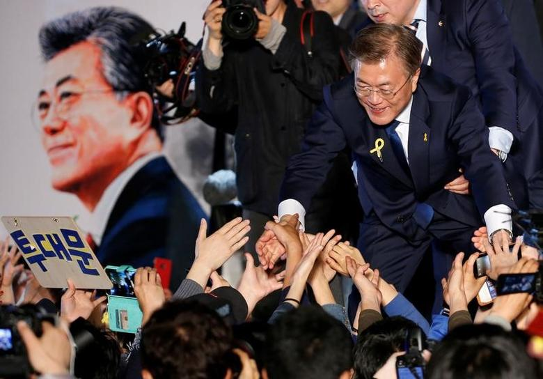 South Korea's president-elect Moon Jae-in thanks supporters at Gwanghwamun Square in Seoul, South Korea, May 10, 2017. REUTERS/Kim Kyung-Hoon