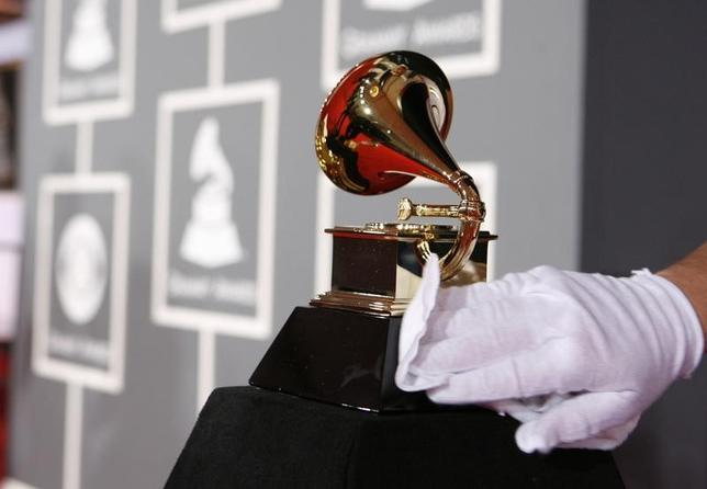FILE PHOTO: A white-gloved worker polishes a Grammy Award before the 51st annual Grammy Awards in Los Angeles February 8, 2009.  REUTERS/Danny Moloshok