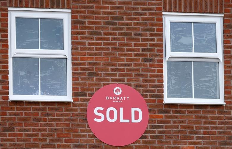 FILE PHOTO - A sold sign hangs on a new house on a Barratt Homes building site in Nuneaton, Britain, March 20, 2014.    REUTERS/Darren Staples/File Photo