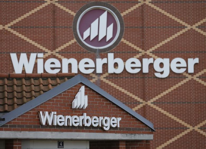 Logos of Wienerberger, the world's biggest brick maker, are pictured at its headquarters in Hennersdorf, Austria, February 9, 2016. REUTERS/Heinz-Peter Bader