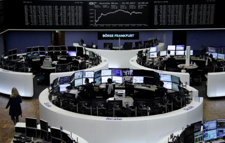 Traders work in front of the German share price index, DAX board, at the stock exchange in Frankfurt, Germany, May 4, 2017. REUTERS/Staff/Remote