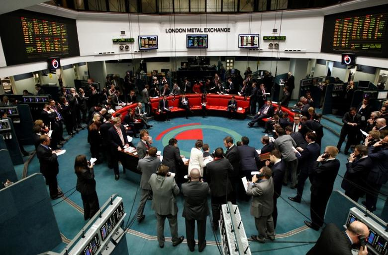 FILE PHOTO: Traders and clerks react on the floor of the London Metal Exchange in the City of London February 14, 2012. REUTERS/Luke MacGregor/File Photo