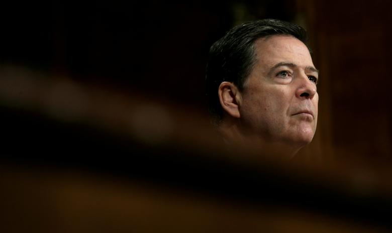 FILE PHOTO: FBI Director James Comey testifies before a Senate Judiciary Committee hearing on ''Oversight of the Federal Bureau of Investigation'' on Capitol Hill in Washington, U.S., May 3, 2017. REUTERS/Kevin Lamarque/File Photo