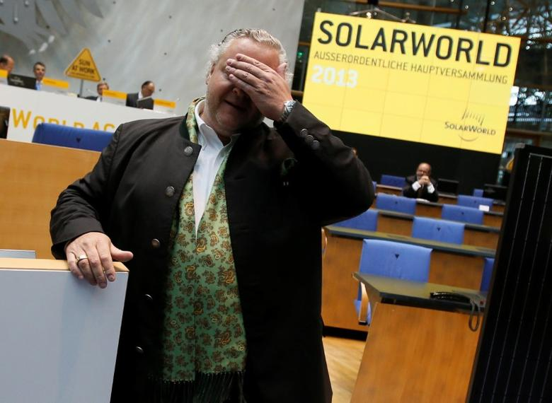 FILE PHOTO: Frank Asbeck, founder and CEO of Germany's SolarWorld reacts before an extraordinary shareholders meeting at the former German lower house of parliament Bundestag in Bonn, August 7, 2013. REUTERS/Wolfgang Rattay/File Photo