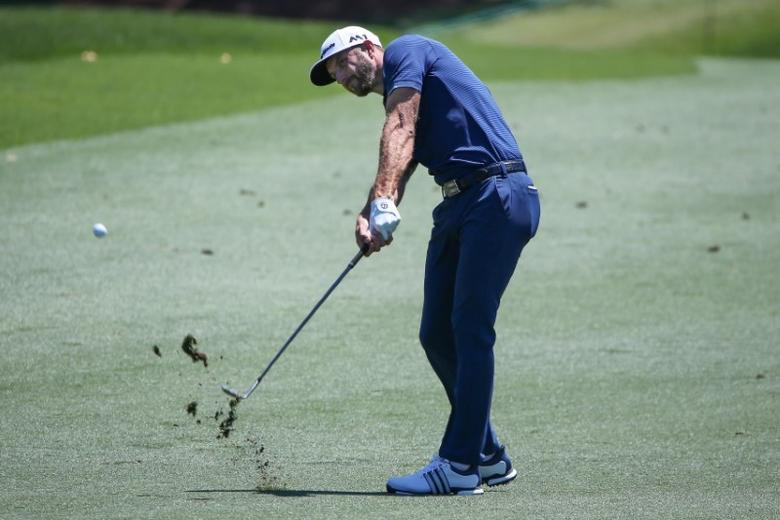 May 7, 2017; Wilmington, NC, USA; Dustin Johnson  hits out of the third fairway during the final round of the Wells Fargo Championship golf tournament  at Eagle Point Golf Club. Mandatory Credit: Jim Dedmon-USA TODAY Sports