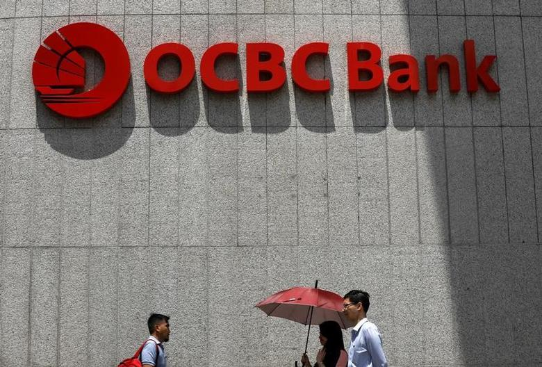 People pass an OCBC Bank office in Singapore April 18, 2017. REUTERS/Edgar Su