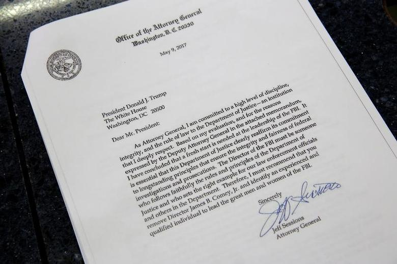 This picture shows a copy of the letter by U.S. Attorney General Jeff Sessions to U.S. President Donald Trump recomending the firing of Director of the FBI James Comey, at the White House in Washington, U.S., May 9, 2017. REUTERS/Joshua Roberts