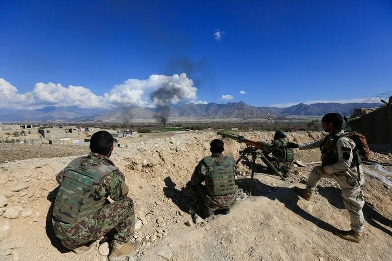 Afghan security forces take position during a gun battle between Taliban and Afghan security forces in Laghman province, Afghanistan March 1, 2017. REUTERS/Parwiz